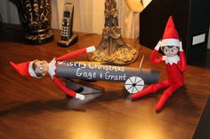 Elf shoots Elf friend from a cannon.  Wrap a paper towel roll in black construction paper.  Draw 2 wheels and cut them out.  Tape them on the sides.  I used a block to prop the front of the cannon b/c the elf is top heavy.  Leave your little one a message on the side of the cannon using a white out pen or some type of paint pen.  Also I used a piece of a zip tie to make it look like a fuse.  Was going to place a match but couldn't find them