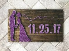 "This board is the perfect gift for a bride and groom!! This listing is for a - made to order - string art sign measuring approximately 20 x 11.25"". Boards will be stained dark walnut and strung with colors of choice! The colors shown in the listing are 3834 for the silhouette and 3835 for the date. If you prefer a color, other than the one shown, please list color selection in notes to seller. Boards do not come with hanging hardware. If you would like to hang your board, please choose that…"