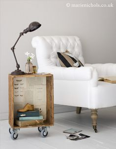 Line old crate with pages of book and add castors for bedside table