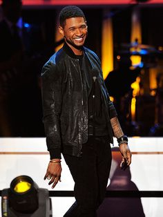 LEAN BACK | Usher puts on a happy face at UNCF's An Evening with the Stars event at Boisfeuillet Jones Atlanta Civic Center Sunday in Georgia.