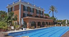 Les Rotes Denia The Hotel Les Rotes occupies a grand building in the Montgó Nature Reserve. Decorated throughout with artworks, there is an outdoor pool and hot tub, fitness room and sauna.  Each room in Les Rotes has a TV and minibars, and some have sea views.