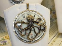 Kraken Pendant with watch dial by KupferdachProduction on Etsy, €100.00
