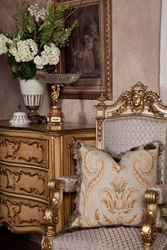 An arrangement of fresh white flowers and greenery compliment a cream and gold color palette of Italian antique furniture perfectly.