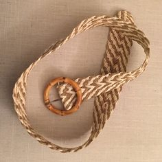 Summer chic belt Cream and twine braided belt with wooden circle belt. Cute way to spice up a solid color summer dress! Anthropologie Accessories Belts