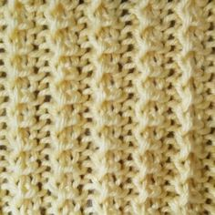 Fancy Rib Stitch = Row 1 (RS): *k2, p1; rep from * to the end of the row. Row 2: *k1, yo, k2, pass yo stitch over previous 2 knit stitches; rep from * to the end of the row. Repeat Rows 1-2.