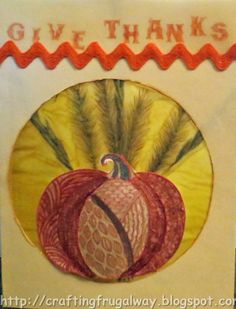 Crafting The Frugal Way: Give Thanks Grass Card. Stamptangle pumpkin sitting on a background of paper with dried grasses sandwiched in between.