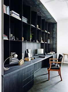 House tour: a spacious 19th-century apartment gets a cool Nordic makeover: Custom shelves by Bundgaard Rützou create an office space at the end of the living room.