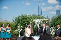 Loving the view of the NYC skyline at this beautiful outdoor ceremony at Liberty House in our gardens!