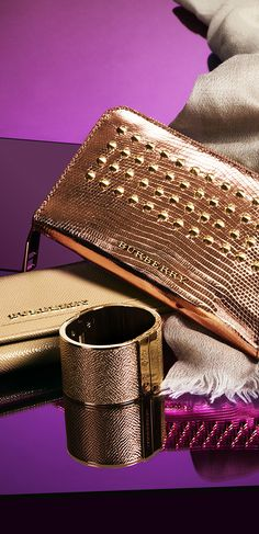 Lustrous fabrics, stud detailing and metallic finishes enhance the elegant S/S13 accessories collection