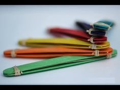 Popsicle Stick Harmonica By: Koen Designer : Unknown Level : Easy Materials: 2 Rubber Bands, 1 Toothpick, 2 Popsicle sticks, 1 Long Piece Of Paper My Blog: h...