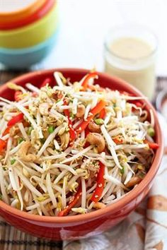 16 Deliciously Healthy Ways to Eat More Bean Sprouts: Tangy Cashew Sesame Bean Sprout Salad with Red Bell Peppers, Green Onions, Raw Cashews.