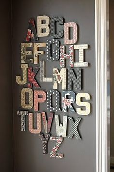Buy wooden letters at Hobby Lobby or your local craft supply store and glue scrapbook paper to them.