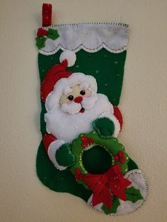 18 Completed Christmas Stocking, SANTA AND WREATH Completed in a smoke and pet-free environment Many upgrades from original kit, listed below Front panel is lined with a fused lining Postage includes first class shipping n a water resistant bag plus insurance  Some of the