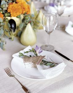 For a country/barn wedding, try this place setting idea: napkins tied with burlap and decorated with fragrant freesia.