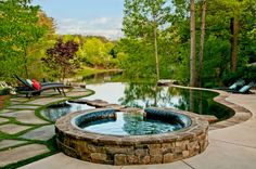 Baroque-paver-patios-in-Pool-Traditional-with-Attractive-Pebble-Sheen-Tec-next-to-Decorative-Stone-Hot-Tub-alongside-Appealing-Patio-Stone-Paver-.jpg (990×658)