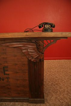 Winged Desk  | The wings that flank the front of this desk are carved out of solid chunks of local Walnut. After creating the 3D model in Blender, the model was sent to our CNC router, where the machine carved the shapes.
