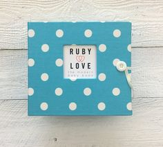 The Polka Dot Album is a modern & stylish Ruby Love baby memory book for documenting your little boy or girl's first year and beyond.