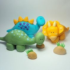 Here coloured fondant icing is moulded into 3 cute little dinosaur figures which would make great cake toppers for any kids dinosaur party cake.