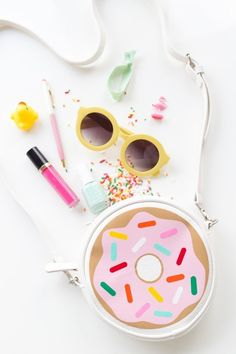 Customize an inexpensive purse with a sprinkled doughnut design. | 19 DIY Doughnut Projects That Are Cute Enough To Eat