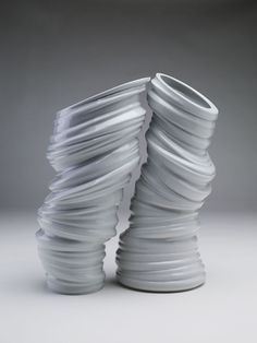 together ... Set of two vases inspired by lines of the lightning fit in to each other creating true symbiosis of a shape. Together they represent power and dynamics of lightnings, and at once are the demonstration of deconstruction and connection. All items in the pure porcelain design.