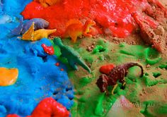 Very, very messy play involving dinosaurs, pretend snow, lava, dust and water.