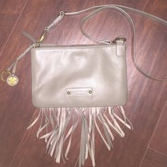 Lucky Brand Bailey Convertible Crossbody Used once. Perfect condition. Has beautiful tassels hanging from it. Two zippered compartments and one middle compartment for storage. Lucky Brand Bags Crossbody Bags