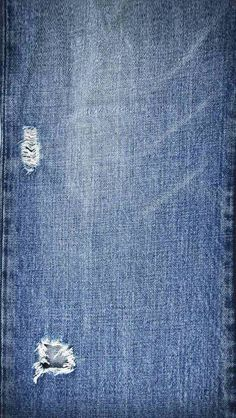 blue jeans stone washed frayed fabric