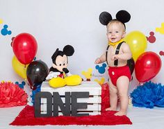 Micky Mouse theme first birthday cake smash photo session. Cake smash photography is a great way to celebrate turning 1!