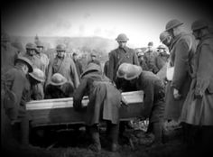 """American Expeditionary Force soldiers burying a hero,    Major Harry A. Harvey, 103rd Field Artillery, 2nd Battery, 26th """"Yankee Division"""", Killed in Action on September 12, 1918 by an Imperial German artillery shell in the Battle of St. Mihiel, France, World War 1. He was a 1915 graduate of West Point Military Academy, he left behind a wife, and a son, R.I.P."""