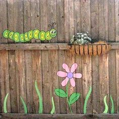 Colorful Painting Ideas for Fences Adding Bright Decorations to Yard Landscaping paint and decorating ideas for fences, yard decorations Garden Fence Art, Garden Mural, Farm Fence, Fence Gate, Fence Landscaping, Backyard Fences, Pallet Fence, Rustic Fence, Fence Stain