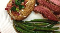 Flank steak is marinated in a flavorful blend of soy sauce, red wine vinegar, and Worcestershire sauce in this tasty grilled dish.
