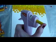 Peel paper off crayon & put in your hot glue gun! Awesomeness