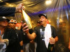 Champagne moment -  Alex Rodriguez #13 of the New York Yankees celebrates their 4-1 win against the Boston Red Sox and their wildcard playoff berth after their game at Yankee Stadium on October 1, 2015 in New York City. - © Al Bello/Getty Images
