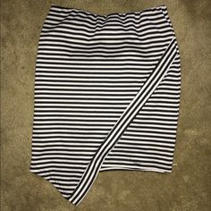 Black and White striped skirt this asymmetrical bodycon skirt gives a perfect shape and can also be worn high waisted Charlotte Russe Skirts Asymmetrical