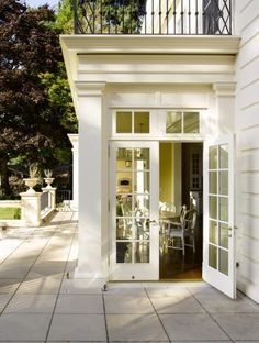 bump out with french doors & transoms | beautiful exterior trimwork