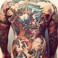 From http://www.shockmansion.com/2014/02/19/ink-addicts-around-the-world-unite-33-photos/  Sick dragon back piece