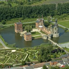 Château d'Havré, On the outskirts of Mons,Belgium, The Castle of Havré consists of a large courtyard, four angle towers of which the dungeon is covered with an onion-shaped dome and a gothic chapel. The entire castle is surrounded by a moat. The estate is home to a rose garden that was developed in 2000. You will find about 15,000 rosebushes, with over 210 different varieties.