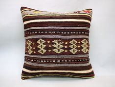 Kilim pillows are the most beautiful trend of using recycled hand-woven fabrics that not only give an extra to your space but also increases the overall look of the room. Besides providing rigidity, kilim pillows also give luxurious texture to any other room. #KilimPillow #KilimCushion #KilimPillowCover #KilimCushionCover #KilimCover #DecorativePillow #VintagePillow #TurkishPillow #ThrowPillow #HandmadePillow #BohoPillow #BohemianPillow #SquarePillow #EthnicCushion #20x20Pillow #Pillow #Cushion Kilim Cushions, Throw Cushions, Bohemian Pillows, Decorative Throw Pillows, 20x20 Pillow Covers, Cushion Covers, Pillow Cases, Geometric Pillow, Vintage Pillows