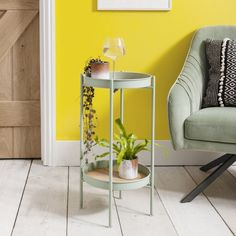 This lovely mint green side table makes a chic accoutrement to your armchair. Fusing function withaesthetics, Solna offers a sophisticated space to pop your glass of wine at the end of the day. Its two-tierdesign is perfect for displaying pretty accessories such as lamps, candles and plants as well asbooks or notepads. The table's refreshing light mint hue is contrasted by pine elements that adddepth to the piece. Available in small or large sizes, the Solna Side ta Living Room Furniture, Home Furniture, Wooden Bedside Table, Table Frame, Nesting Tables, Wooden Shelves, Mint Green, Hue