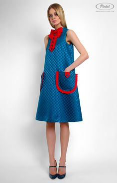 Sleeveless A-shape dress trimmed with cotton ribbon. Band collar. Back box pleat. Decorative placket with buttons and designer handmade bow. Hidden back zip closure. Patch pockets. On the photo: model is wearing a size S and is 181 cm.