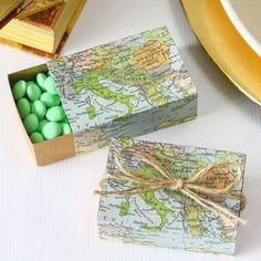 """Around the World"" map favor boxes are the perfect accessory for a travel themed baby shower."