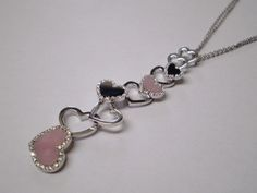 18kt gold pendant with diamonds and pink opal and onix hearts