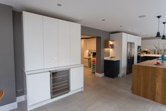 This bespoke pantry was commissioned as a Drinks Cabinet with integrated wine cooler. It has been designed to fit with large family kitchen using the same flat slab doors but with bi-fold opening doors. Hand painted in Farrow and Balls All White. Integrated Wine Cooler, Slab Doors, Drinks Cabinet, Family Kitchen, All White, Kitchen Furniture, Bespoke, Pantry, Balls