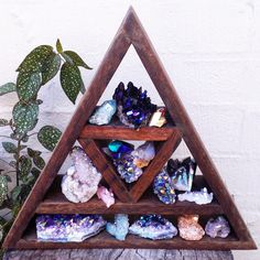 Display your crystals with this Beautiful Triangular Crystal Shelf, Handmade by us with recycled wood. Also a great gift for your fellow crystal lovers! Our Wooden Crystal Shelves are also extremely sturdy and you can rest assured when you buy from us. Please note that it is handmade, and may have markings that add to the uniqueness of the piece. Measures: Height 29cm x Width 33cm x Depth 7cm