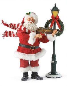 Department 56 Possible Dreams Silent Night Santa, 12.4-Inch by Department 56, http://www.amazon.com/dp/B007GPYB0C/ref=cm_sw_r_pi_dp_a3F7pb0R6AASK
