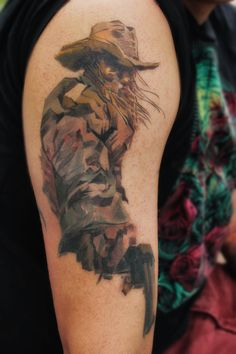 Unique Cowboy with Revolver Tattoo.