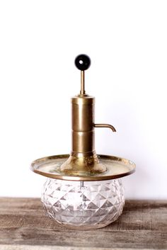 I Can't Believe It's From Etsy: Vintage Barware: This 1950s vintage shot dispenser ($80) from Park Sherman features a brass tray and a glass bottom.