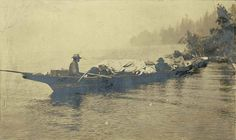Chudups John and others in a canoe on Lake Union, Seattle, ca. 1885
