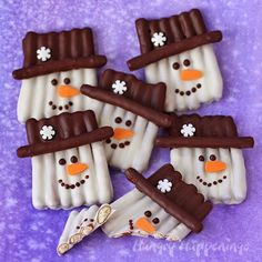 Chocolate Pretzel Snowman Craft - Snowman with hat pretzels. Put together pretzels to form a cute looking snowman with a hat treat. Add little details such as the face and snowflake on the hat design for accent.