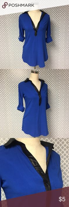 Rue21 Faux Leather Collar Tunic Career Top ▪️ Description: Rue21 Womens Size small half Button Down v neck career Blouse. Gorgeous royal blue with pocket and black Faux leather collar. It's a Tunic so it looks great with leggings or skinny jeans. This top fits big more like a medium so please read measurements below.  ▪️ Measurements: * Pit to Pit - 20 inches * Shoulder to Hem - 26.5 inches *  ▪️ Condition: Excellent used condition. No noticeable flaws.         💎Price is Firm💎 ⭐️15% Off…
